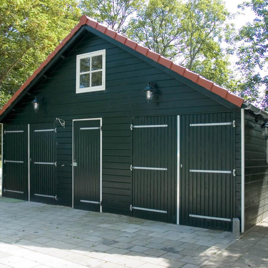 Garage met Zweeds potdeksel gerealiseerd door ABS Bouwsystemen